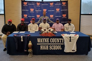 Six WCHS Football Players sign scholarships