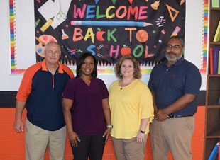 Supporting School Attendance Awareness Month is Wayne County High School supervising principal Robert Hathorn and counselors Yolanda Stewart, Dawn Wallace and LaCedric Powe.