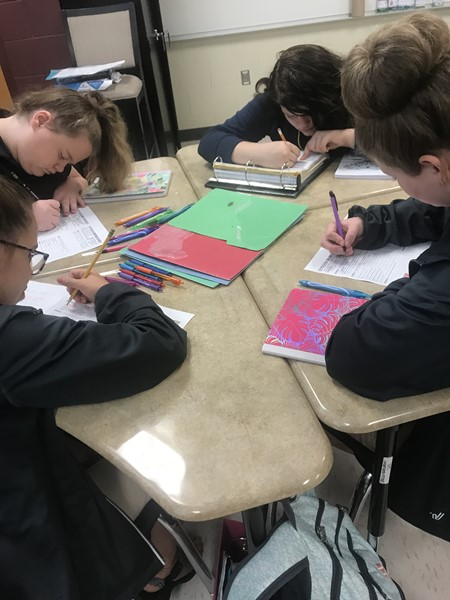 7th grade taking notes in Mrs. McAndrews's class