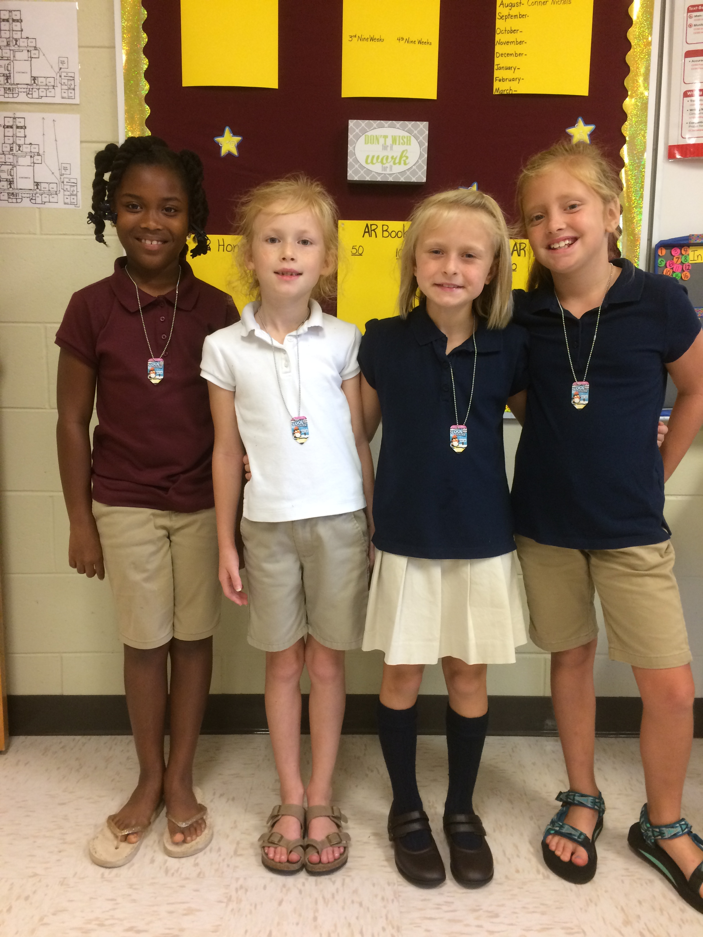 The first four third grade students to reach their 50 AR book goal this year.